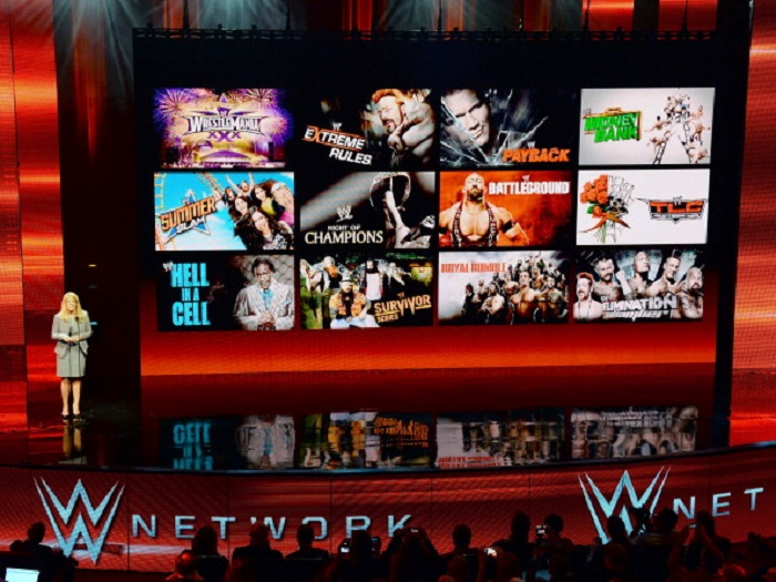 LAS VEGAS, NV - JANUARY 08: WWE Chief Revenue and Marketing Officer Michelle Wilson speaks at a news conference announcing the WWE Network at the 2014 International CES at the Encore Theater at Wynn Las Vegas on January 8, 2014 in Las Vegas, Nevada. The network will launch on February 24, 2014 as the first-ever 24/7 streaming network, offering both scheduled programs and video on demand. The USD 9.99 per month subscription will include access to all 12 live WWE pay-per-view events (pictured on screen) each year. CES, the world's largest annual consumer technology trade show, runs through January 10 and is expected to feature 3,200 exhibitors showing off their latest products and services to about 150,000 attendees. (Photo by Ethan Miller/Getty Images)